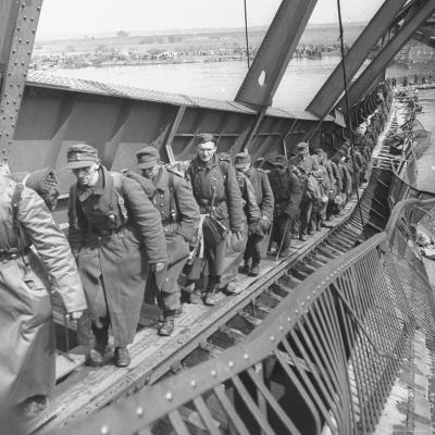 German Soldiers Walk over Elbe River to Surrender to Allied Forces in the Waning Days of WWII-William Vandivert-Photographic Print