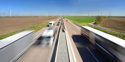 Germany, Saxony-Anhalt, Truck and Car in Motion Blur-Andreas Vitting-Photographic Print
