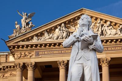https://imgc.artprintimages.com/img/print/germany-wiesbaden-hessian-state-theatre-schiller-monument_u-l-q11w4lg0.jpg?p=0
