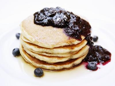 A Pile of Pancakes with Blueberry Sauce and Maple Syrup by Gerrit Buntrock