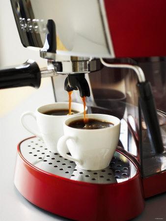 Espresso Running into Espresso Cups