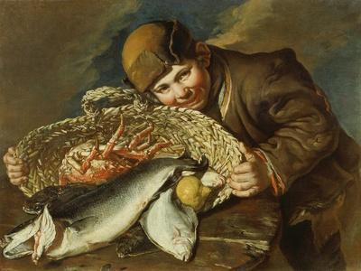 Boy with a basket full of sea food