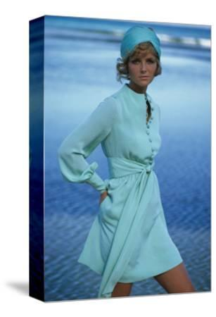Model Cheryl Tiegs on Beach Wearing Light Green Acetate and Rayon Dress by Stan Herman for Mr. Mort