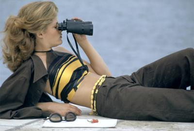 Model Is Reclining Wearing Brown Pant Suit with Yellow and Brown Halter by Ken Scott by Gianni Penati