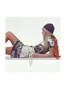 Model, Reclining on Her Elbows, Wearing a Shirt Dress in a Navy and White, Japanese-Inspired Print by Gianni Penati