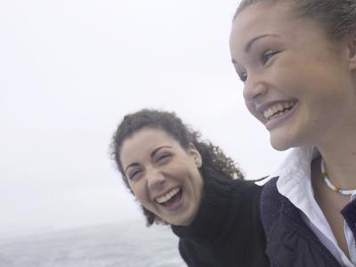 Giggling Women Standing on Edge of Water--Photographic Print