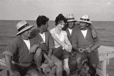 Gina Lollobrigida on the Seashore with Lifeguards--Photographic Print