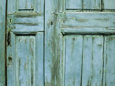 Detail of a Colorful Old Door with Peeling Paint