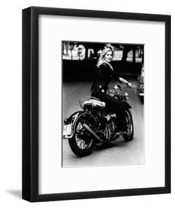 Giovanna Rides a High-powered Motorbike