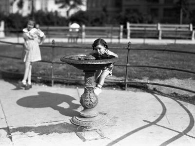 Girl (4-5) Drinking from Water Fountain, (B&W)-George Marks-Photographic Print
