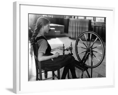 Girl at a Spinning Wheel--Framed Photographic Print