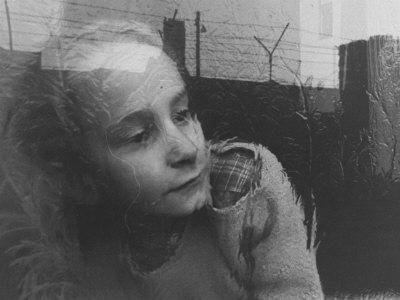 https://imgc.artprintimages.com/img/print/girl-gazing-pensively-through-pane-of-her-apartment-window-grimly-reflects-image-of-berlin-wall_u-l-p47bj60.jpg?artPerspective=n