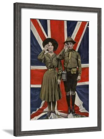 Girl Guide and Boy Scout Saluting in Front of the Union Flag--Framed Photographic Print