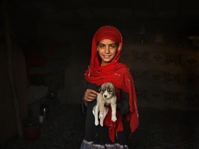 Girl Holds a Puppy as the Sun Sets over Kabul's Impoverished Teppe Maranjan Neighborhood--Photographic Print