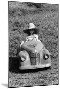 Girl in a 1948 Vintage Austin J40 Pedal Car