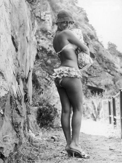 Girl in Bikini Walks Along a Cliff Path on a Fine Summer Day--Photographic Print