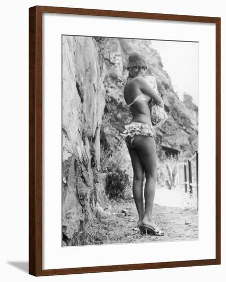 Girl in Bikini Walks Along a Cliff Path on a Fine Summer Day--Framed Photographic Print