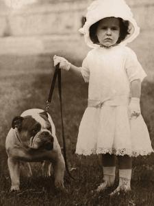 Girl in Dress and Hat, Holding Bulldog on Lead