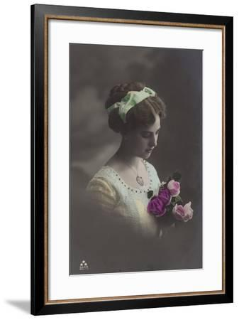 Girl Peering into Bunch of Roses--Framed Photographic Print
