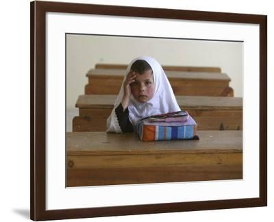 Girl Sits Alone in Her Class Room During a Break in Aftabachi School in Eastern Afghanistan--Framed Photographic Print