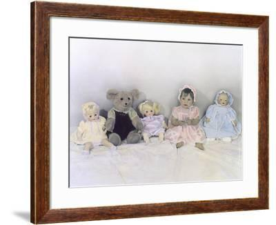 Girl Sitting Against Wall with Dolls and Teddy Bear-Nora Hernandez-Framed Giclee Print