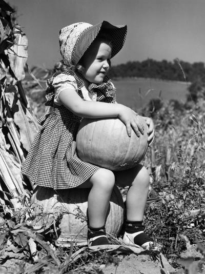 Girl Sitting on Pumpkin, Wearing Sun Bonnet-H^ Armstrong Roberts-Photographic Print