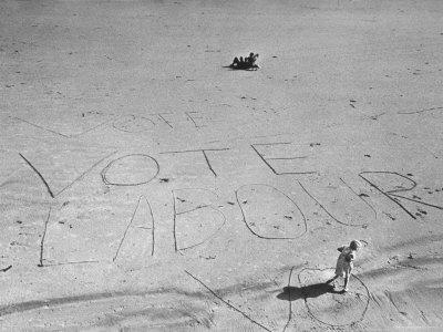https://imgc.artprintimages.com/img/print/girl-standing-by-the-words-vote-labour-written-in-the-sand_u-l-p3n89s0.jpg?p=0