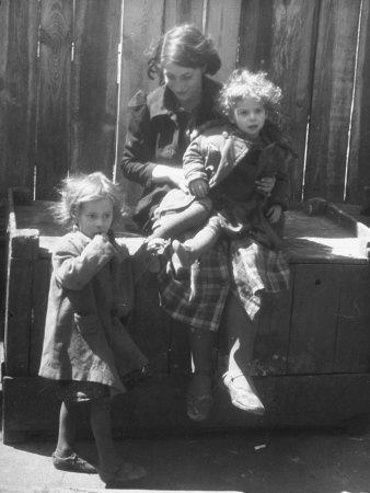 https://imgc.artprintimages.com/img/print/girl-watching-over-her-sisters-in-a-pre-war-jewish-quarter-area_u-l-p74ru00.jpg?p=0