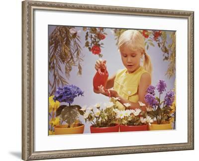 Girl Watering Flowers-Dennis Hallinan-Framed Photographic Print
