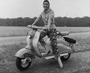 Girl Wearing a Headscarf and Jazzy Slacks Models a Lambretta Ld 125 Mark IV Scooter