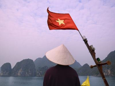 Girl with Conical Hat on a Junk Boat with National Flag and Karst Islands in Halong Bay, Vietnam-Keren Su-Photographic Print