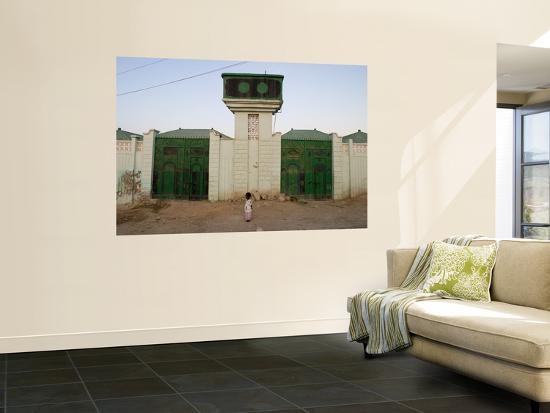 Girl with Traditional Somali Residential Water Storage Tank Above Her-Orien Harvey-Wall Mural