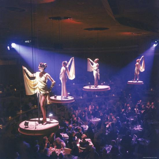 Girls from the Famed Paris Lido Show Performing on Raised Platforms at Stardust Hotel and Casino-Ralph Crane-Photographic Print