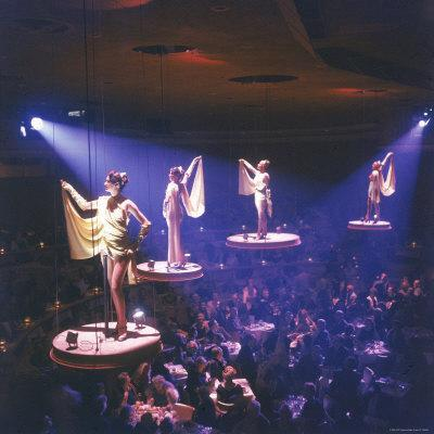 https://imgc.artprintimages.com/img/print/girls-from-the-famed-paris-lido-show-performing-on-raised-platforms-at-stardust-hotel-and-casino_u-l-p4334h0.jpg?p=0