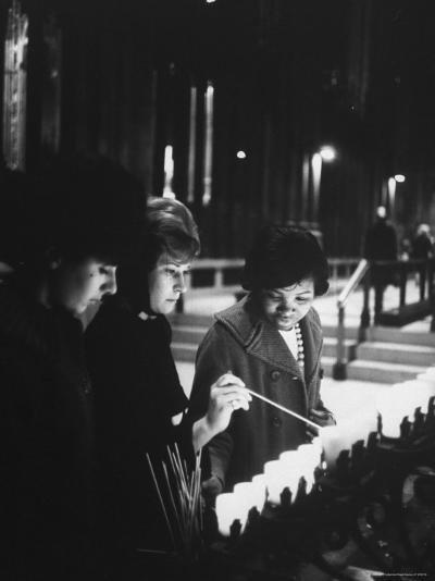 Girls Lighting Votive Candles at a Shrine in St. Patrick's Cathedral, in Prayer For John F. Kennedy-Ralph Morse-Photographic Print