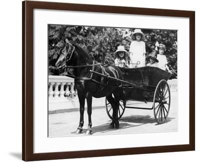 Girls Travelling in Horse Drawn Carriage--Framed Photographic Print