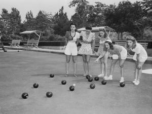 Girls Wait for the Final Bowl Before Adding up the Score