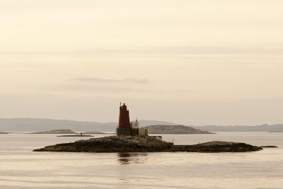 Gjaeslinga Lighthouse Set on a Small Rock Island Among Islands in the Norwegian Sea-Sergio Pitamitz-Photographic Print