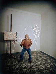 Artist Pablo Picasso Attempting to Draw a Minotaur Using Light Pen, Vallauris, France, 1949 by Gjon Mili