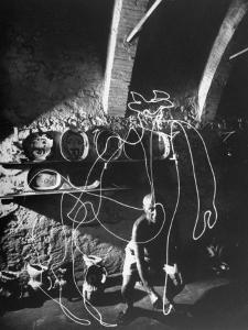 "Artist Pablo Picasso ""Painting"" with Light at Madoura Pottery by Gjon Mili"