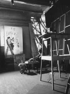 Artist Saul Steinberg at Work in Gjon Mili's Studio on Murals for Terrace Plaza Hotel in Cincinnati by Gjon Mili