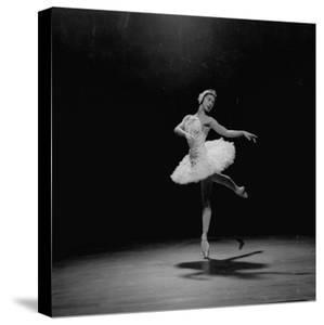 Ballerina Margot Fonteyn in White Costume Balanced on One Toe While Dancing Alone on Stage by Gjon Mili