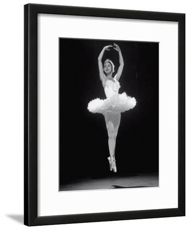 Ballerina Margot Fonteyn in White Costume Leaping into the Air While Dancing Alone on Stage