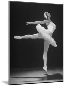 Ballerina Margot Fonteyn in White Tutu Dancing Alone on Stage by Gjon Mili