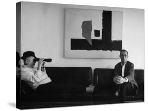 Billy Wilder in His Hollywood Office, Looking Through Binoculars by Gjon Mili