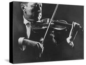 Close Up of Violinist Jascha Heifetz Playing in Mili's Darkened Studio by Gjon Mili