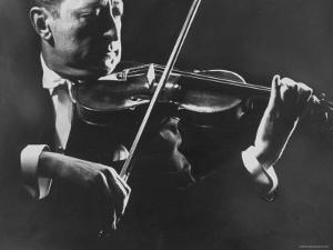 Close Up of Violinist Jascha Heifetz Playing in Mili's Darkened Studio by Gjon Mili