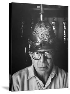 Director Billy Wilder in His Hollywood Office Wearing German Helmet by Gjon Mili
