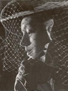 Double Exposure of Model Wearing Hat with Heavy Face Veil, c.1946 by Gjon Mili