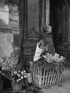 Elderly Woman Selling Flowers Outside Gallerie du Bac, Paris by Gjon Mili